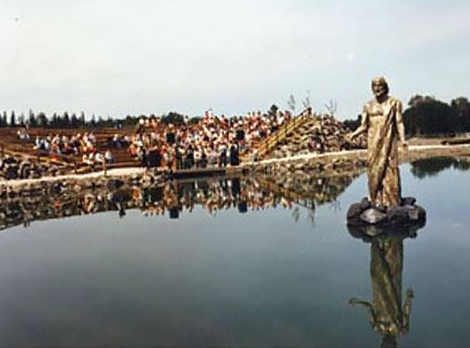 Image of statue of Jesus, man-made lake and amphitheater at 108 Mile Ranch.