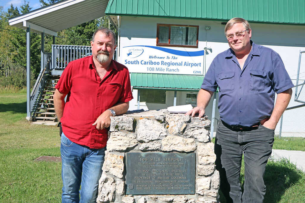 Incoming new manger for the South Cariboo Regional Airport Ross Donahue poses with his friend and outgoing manger Nick Christianson. (Patrick Davies photo - 100 Mile Free Press)